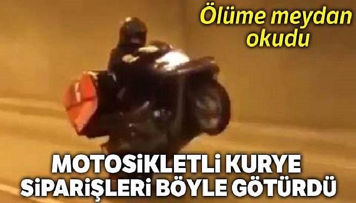 İstanbul'da motosikletli kurye müşterilere siparişleri tek teker üzerinde götürdü