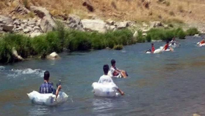 Pet şişe dolu torbayla rafting heyecanı