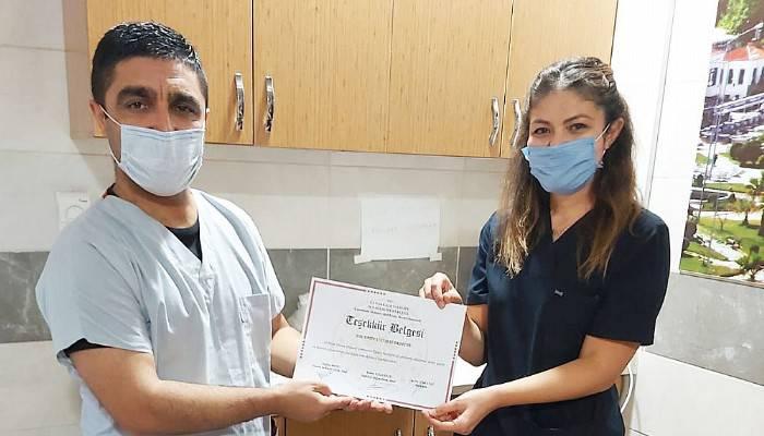 Başhekim Tali'den klinik çalışanlarına teşekkür belgesi