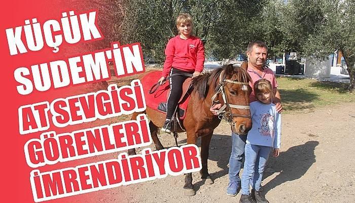11 yaşında at binip, engeller üzerinden atlıyor
