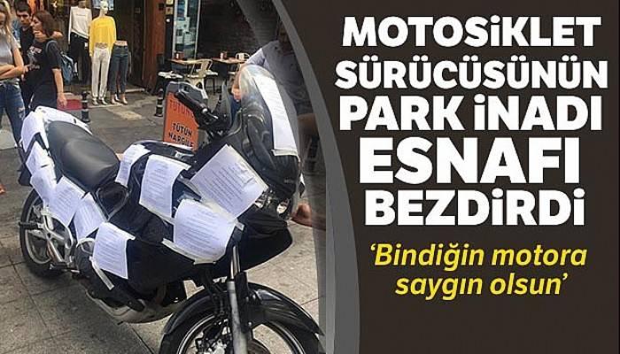 Motosiklet sürücüsünün park inadı esnafı bezdirdi