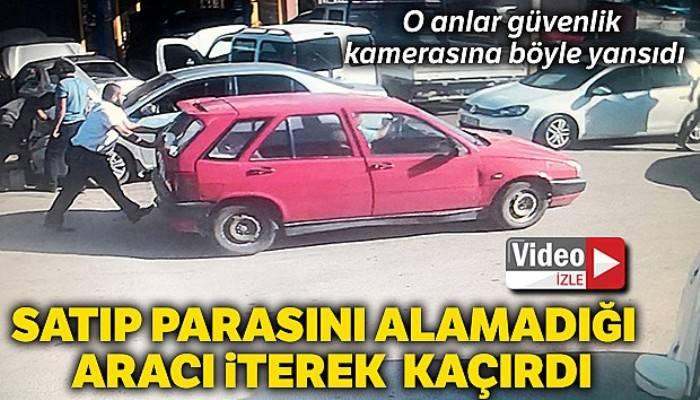 Satıp parasını alamadığı otomobilini iterek kaçırırken güvenlik kamerasına yakalandı